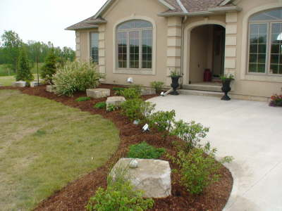completed by a m stone ltd landscaping front entrance landscape